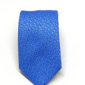 Cravatta seta azzurra fiori in tinta